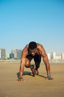 Athlete doing HIIT on the beach