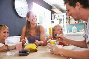 bigstock-Family-Eating-Breakfast-At-Kit-87992090.jpg